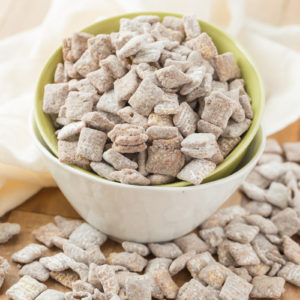 Muddy Buddies ~ crunchy cereal coated with chocolate, peanut butter and powered sugar. This is one kid approved snack and the best news is it takes minutes to throw together!