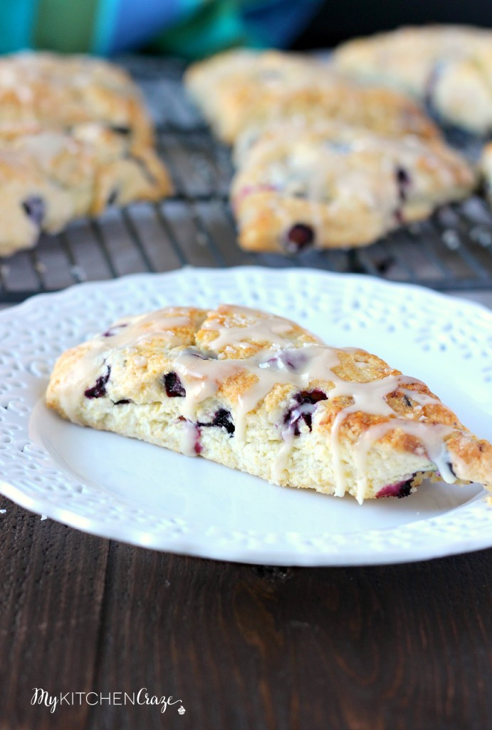 Blueberry Scones with Vanilla Glaze ~ www.mykitchencraze.com ~ A moist and fruity scone topped with a smooth glaze. Perfect with a cup of coffee/tea!