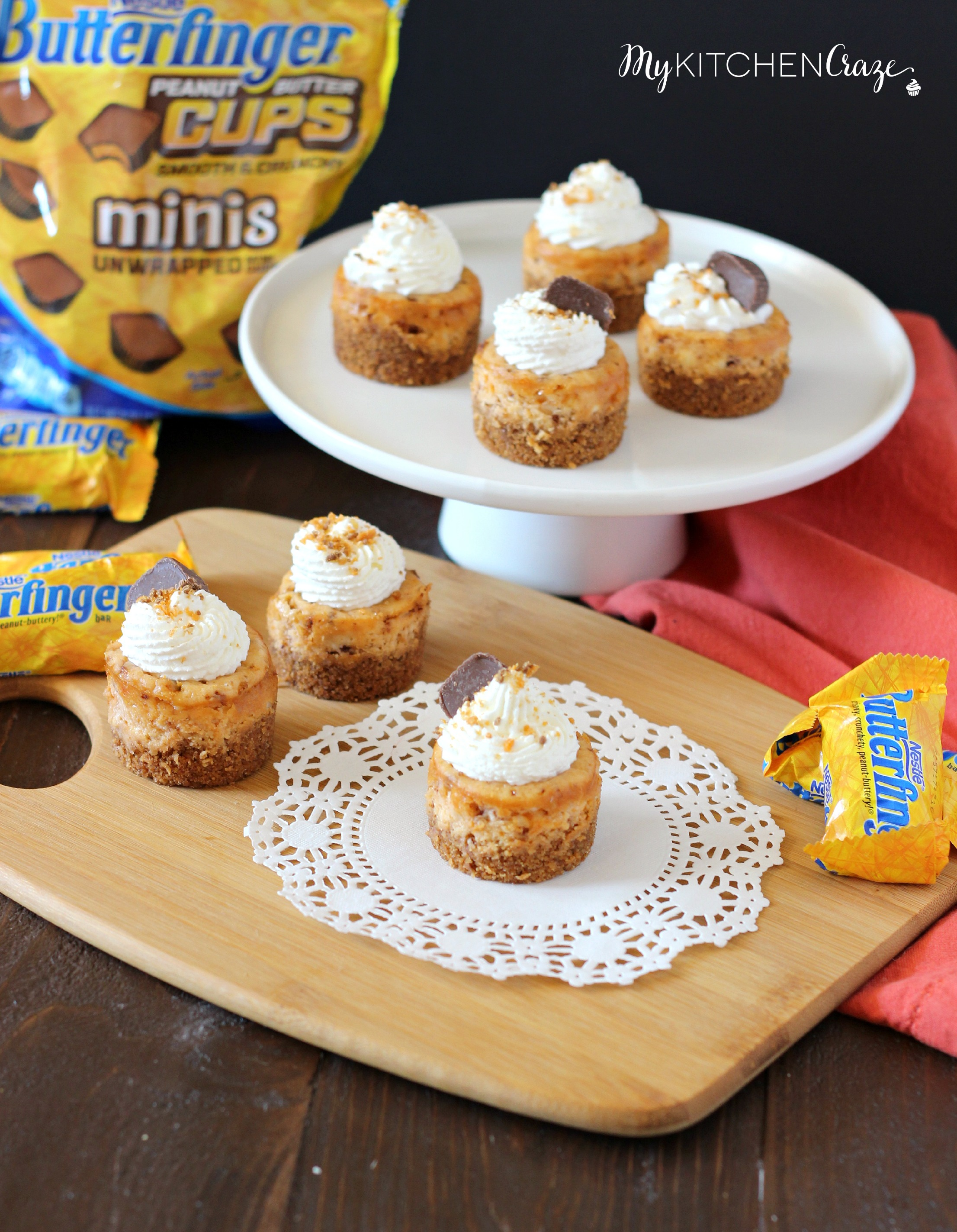 Mini Butterfinger Cheesecakes ~ mykitchencraze.com ~ Delicious cheesecakes swirled with butterfingers candies and topped with whipped cream! Yum!