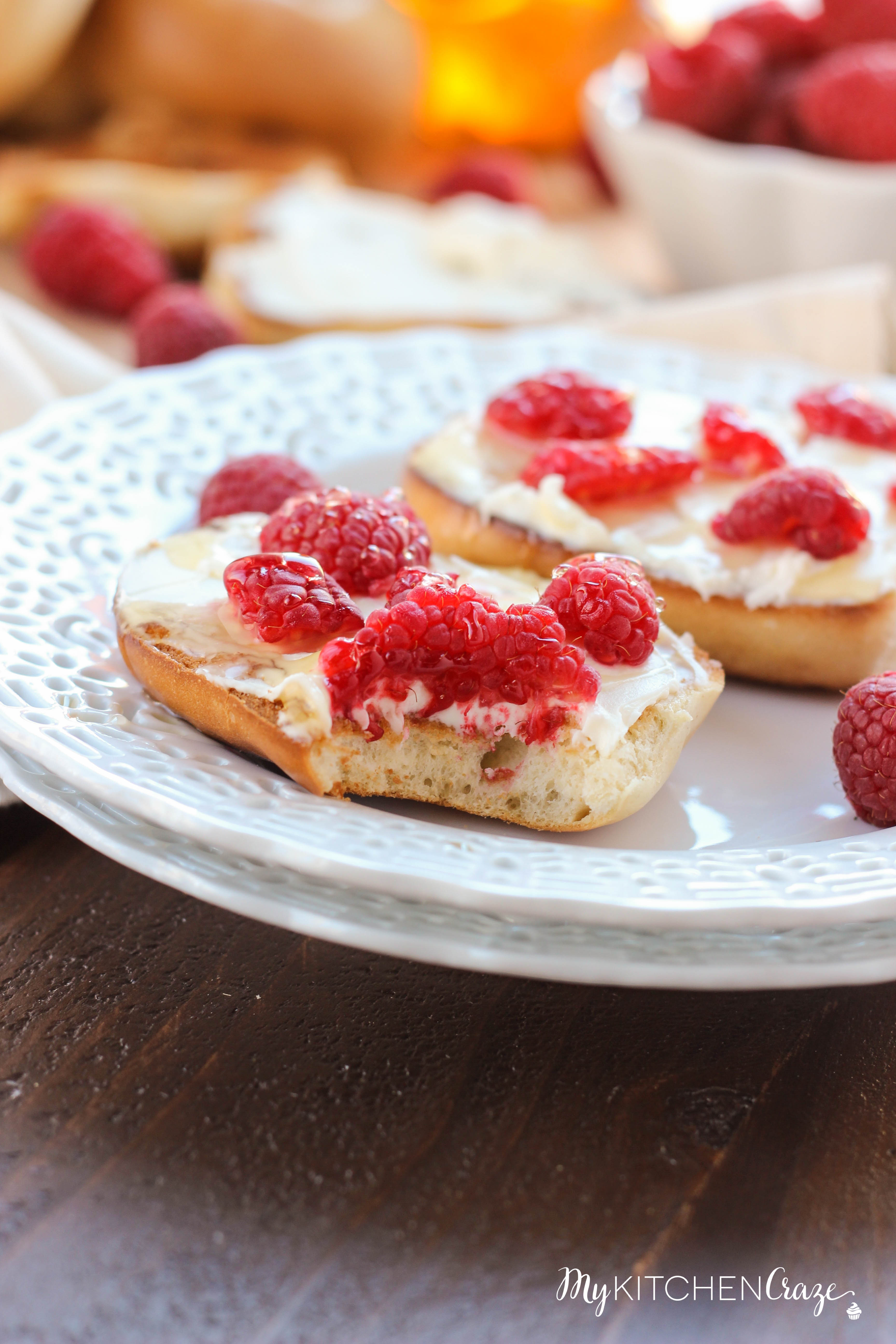 Honey Raspberry Bagels ~ mykitchencraze.com ~ Enjoy these easy 4 ingredient bagels for a quick breakfast or dessert. Loaded with mascarpone cheese, raspberries and honey. These bagels will be gone before you know it.