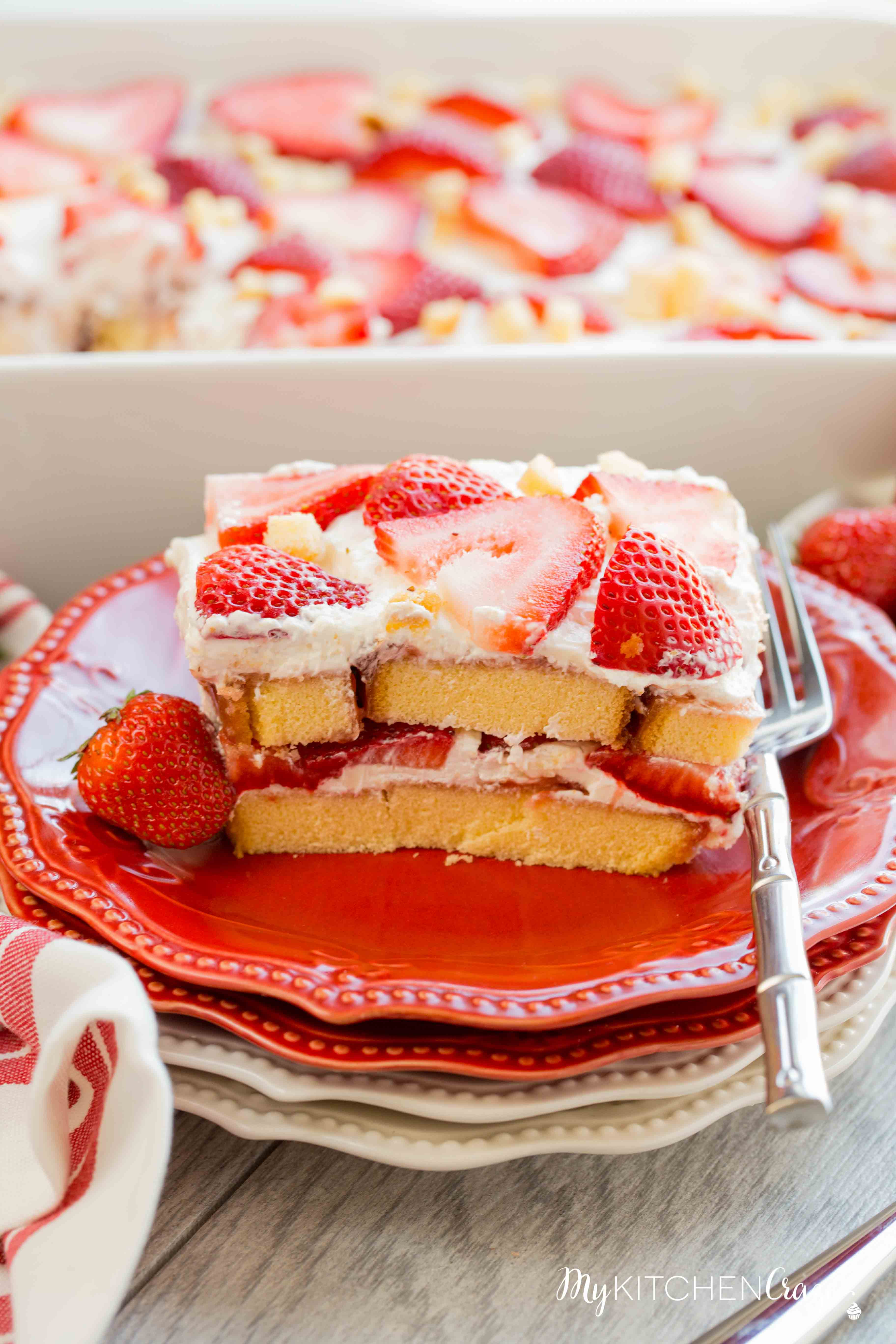 Strawberry Tiramisu ~ mykitchencraze.com ~ Enjoy this delicious and fun twist on tiramisu! Loaded with strawberries, pound cake, mascarpone cheese and cool whip. This is one dessert you won't be able to pass up!