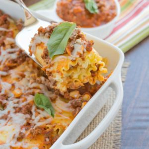 Lasagna Roll-Ups ~ mykitchencraze.com ~ A fun twist and easy way to make lasagna. These roll-ups are filled with everything you'd put in your lasagna, but better. The family will love them!