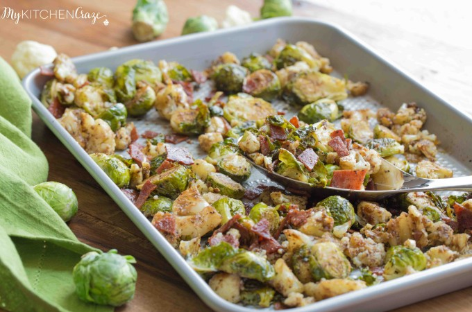Roasted Brussel Sprouts with Bacon & Cauliflower ~ mykitchencraze.com ~ A delicious side dish loaded with roasted Brussel Sprouts and cauliflower, crispy bacon. Then topped with a delicious balsamic vinaigrette. It's the perfect side dish for any meat and the kids will love it!