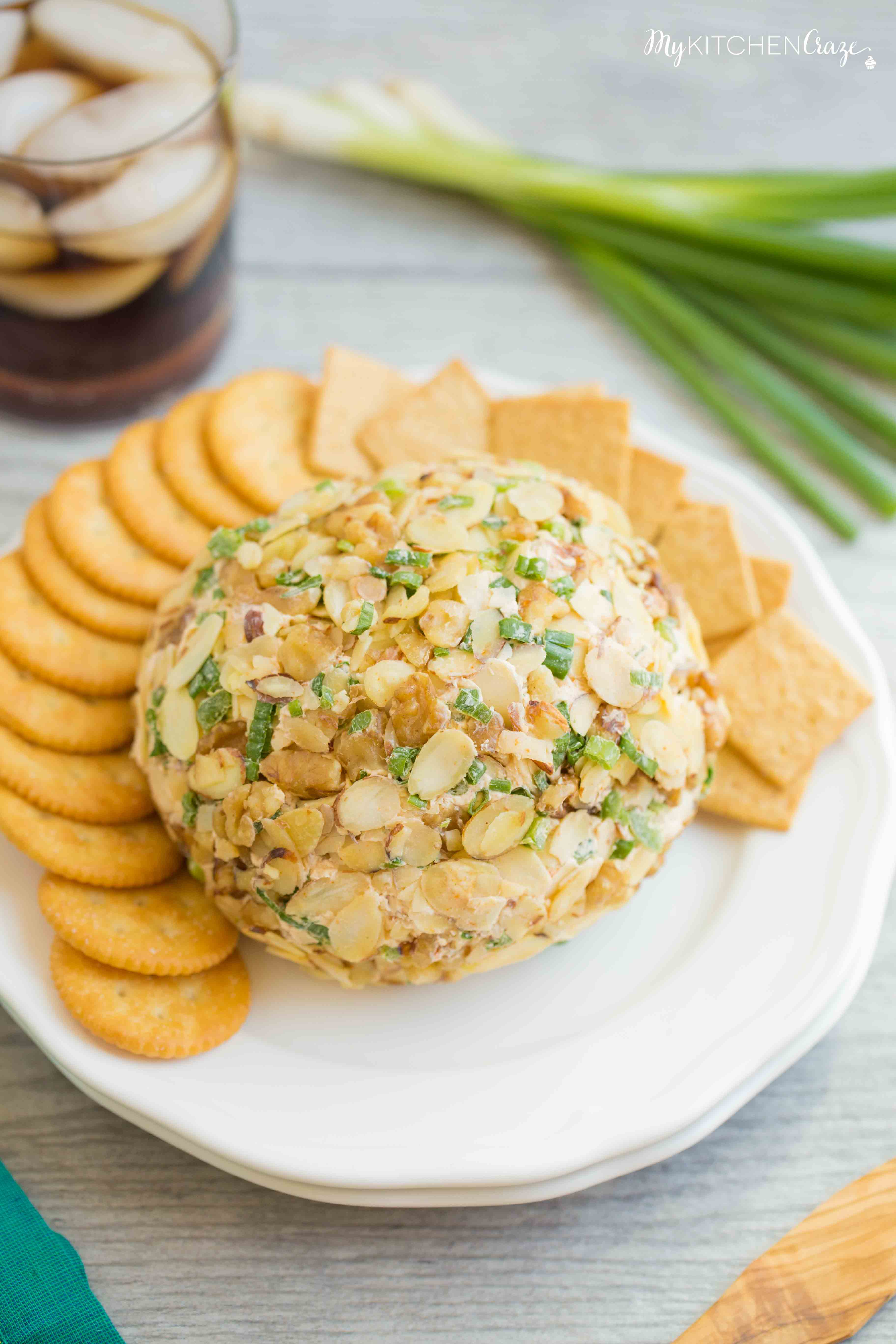 Spicy Cheese Ball ~ Loaded with cream cheese, spices, jalapeños, shredded cheeses & fresh veggies. This is one cheese ball bundled with rich creamy goodness!