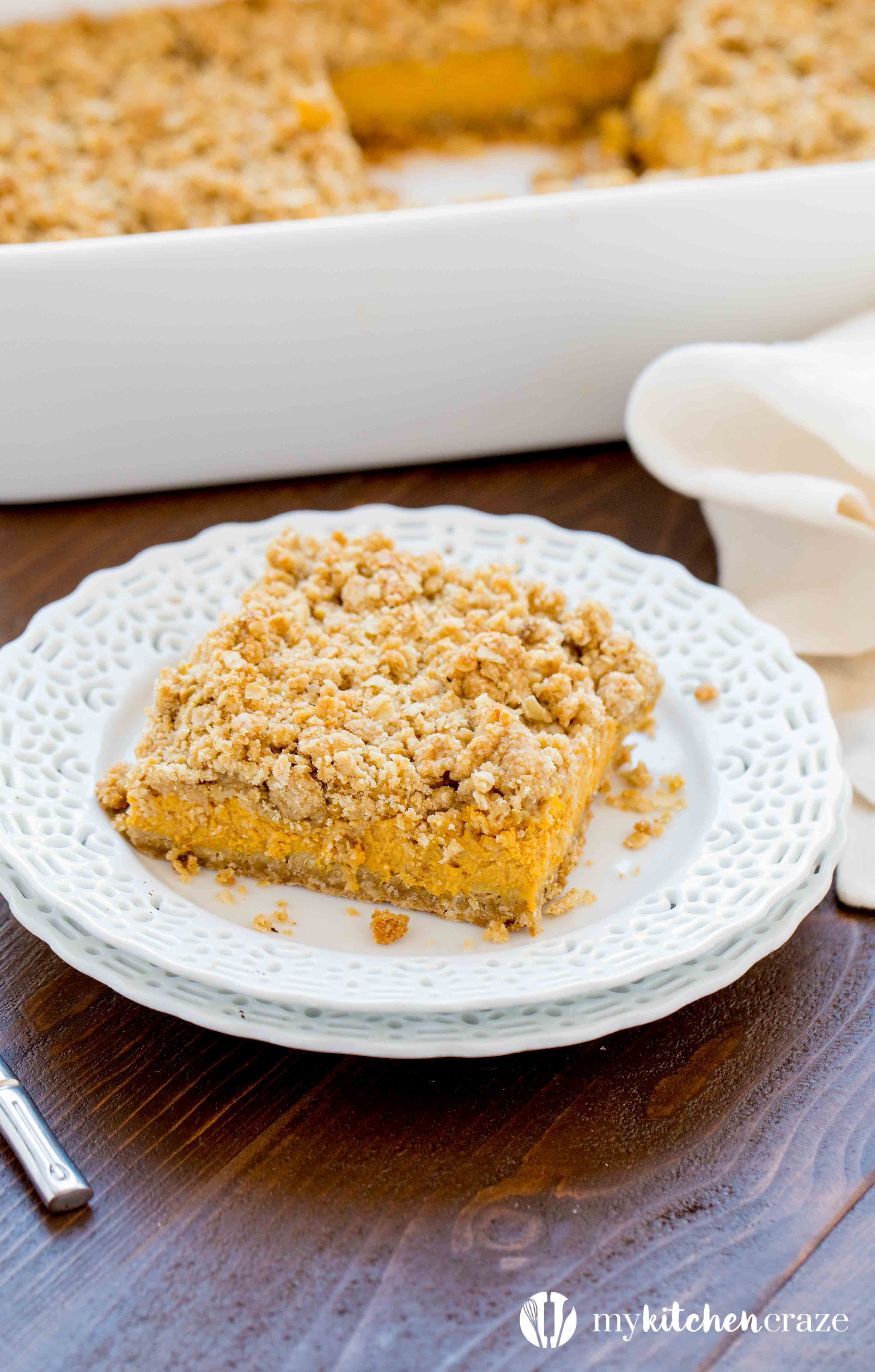 Pumpkin Cheesecake Bars ~ When you combine pumpkin & cheesecake together, what do you get? Delicious PUMPKIN CHEESECAKE BARS! These bars are creamy with a crunchy topping and crust. Yum!