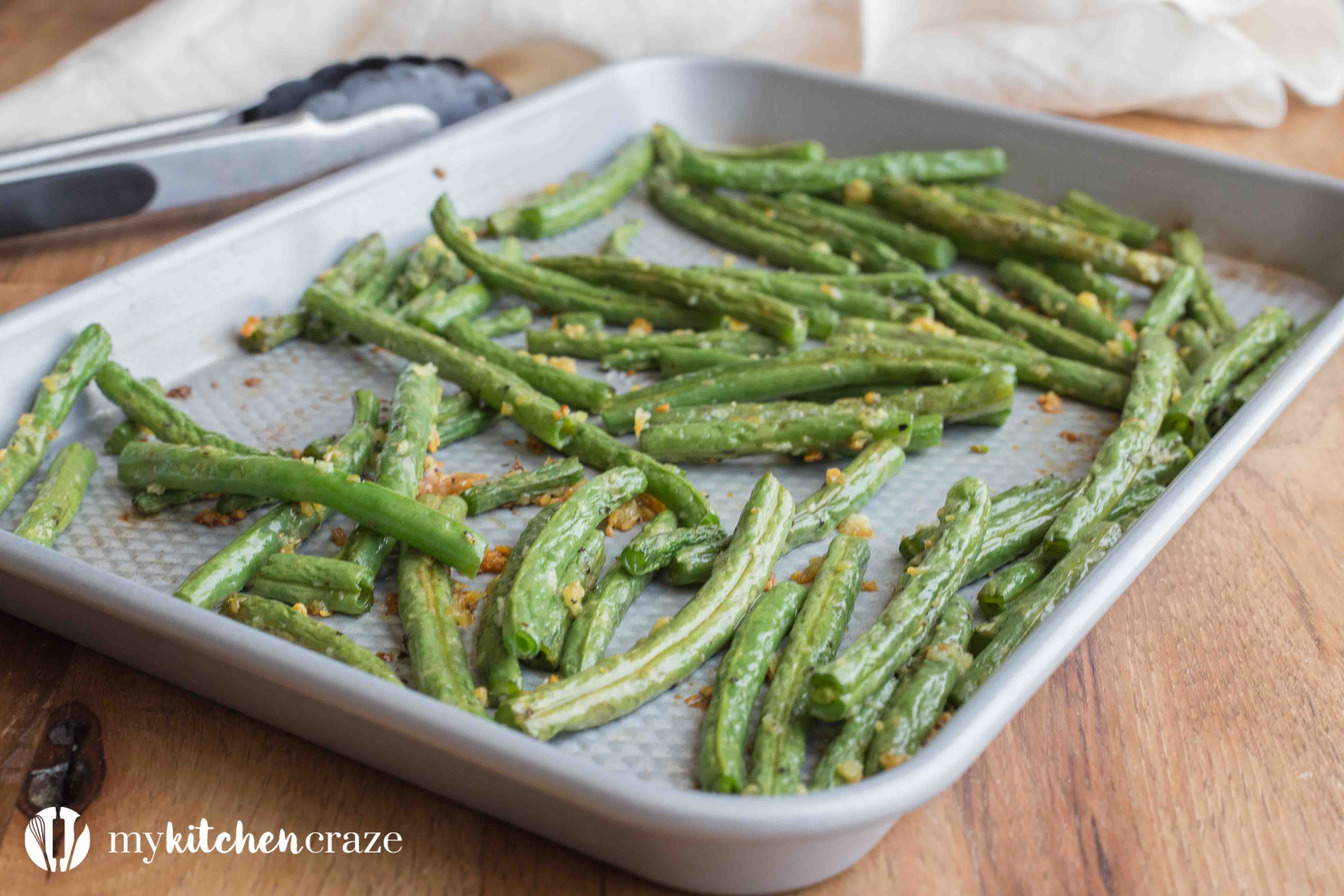Baked Garlic Green Beans are a simple and delicious side dish that will compliment any main entree. Crunchy green beans and roasted garlic, make this one easy yummy side!
