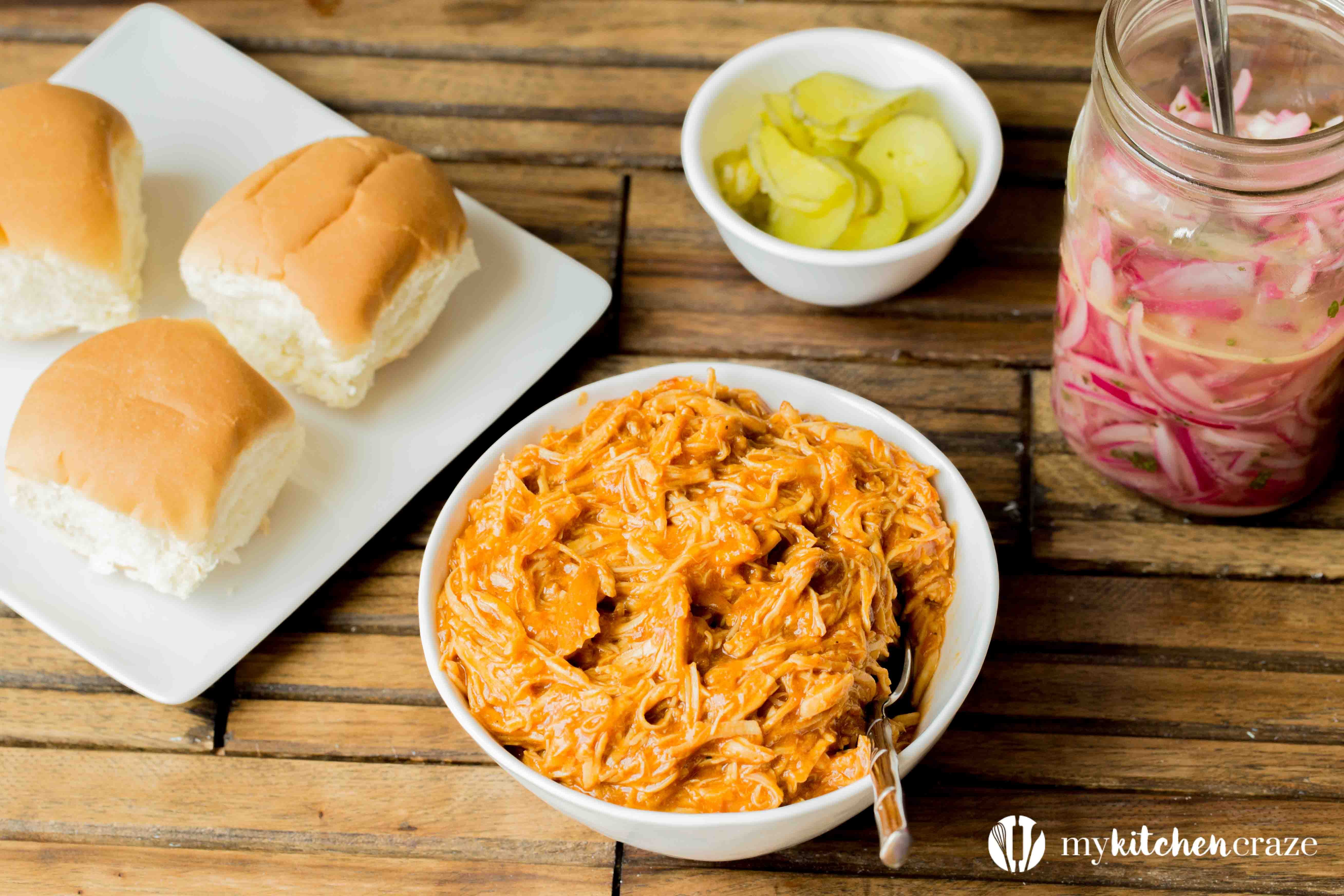 BBQ Pulled Chicken Sliders are packed with delicious flavor! The chicken is slow cooked with Barbecue sauce then shredded or 'pulled' and piled on top of slider rolls. Perfect for a busy night or a fun gathering!