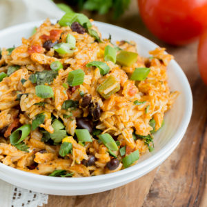 Slow Cooker Southwest Chicken and Rice is a meal you won't want to pass up. This dish has everything you need for a yummy dinner. Loaded with chicken, veggies, rice and of course cheese.